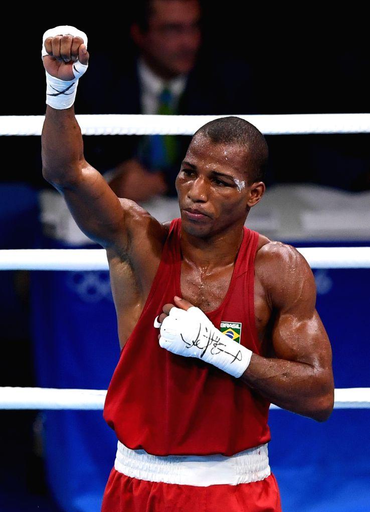 RIO DE JANEIRO, Aug. 16, 2016 - Brazil's Robson Conceicao celebrates after the men's light (60kg) final of Boxing against France's Sofiane Oumiha at the 2016 Rio Olympic Games in Rio de Janeiro, ...
