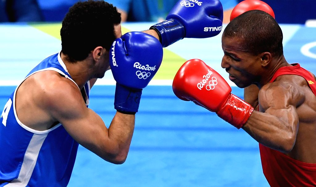 RIO DE JANEIRO, Aug. 16, 2016 - Brazil's Robson Conceicao (R) competes against France's Sofiane Oumiha during the men's light (60kg) final of Boxing at the 2016 Rio Olympic Games in Rio de Janeiro, ...