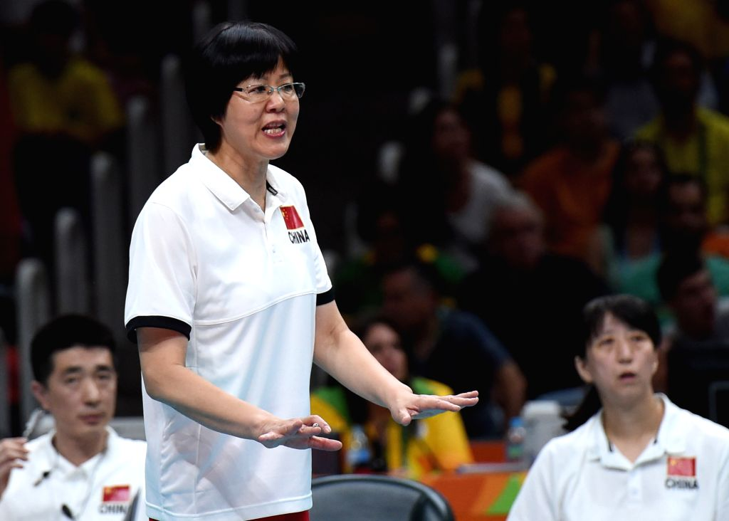 RIO DE JANEIRO, Aug. 16, 2016 - China's head coach Lang Ping reacts during a women's quarterfinal of Volleyball between China and Brazil at the 2016 Rio Olympic Games in Rio de Janeiro, Brazil, on ...