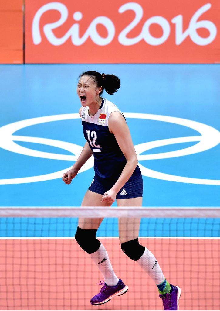 RIO DE JANEIRO, Aug. 16, 2016 - China's Hui Ruoqi celebrates for scoring against Brazil during a women's quarterfinal of Volleyball at the 2016 Rio Olympic Games in Rio de Janeiro, Brazil, on Aug. ...