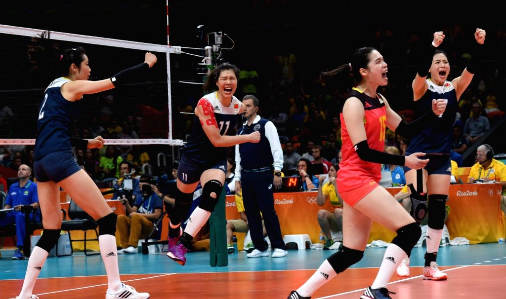 RIO DE JANEIRO, Aug. 16, 2016 - China's players celebrate after a women's quarterfinal of Volleyball between China and Brazil at the 2016 Rio Olympic Games in Rio de Janeiro, Brazil, on Aug. 16, ...