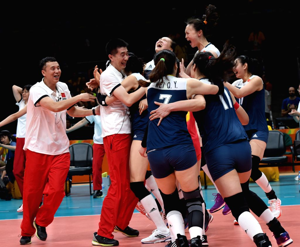 RIO DE JANEIRO, Aug. 16, 2016 - China's players and coaches celebrate after a women's quarterfinal of Volleyball between China and Brazil at the 2016 Rio Olympic Games in Rio de Janeiro, Brazil, on ...