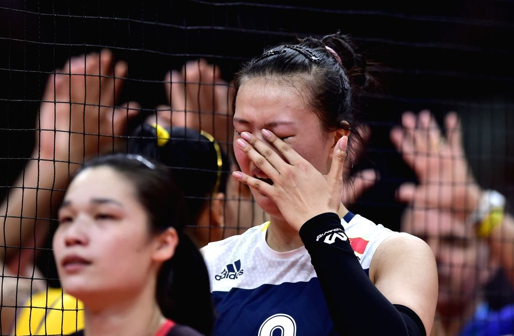 RIO DE JANEIRO, Aug. 16, 2016 - China's Zhang Changning (R) reacts after a women's quarterfinal of Volleyball between China and Brazil at the 2016 Rio Olympic Games in Rio de Janeiro, Brazil, on Aug. ...