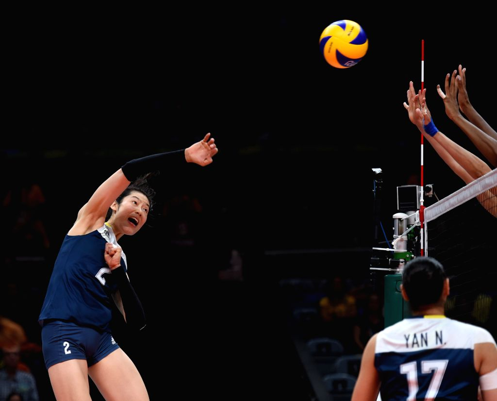RIO DE JANEIRO, Aug. 16, 2016 - China's Zhu Ting (1st, L) spikes the ball during a women's quarterfinal of Volleyball between China and Brazil at the 2016 Rio Olympic Games in Rio de Janeiro, Brazil, ...
