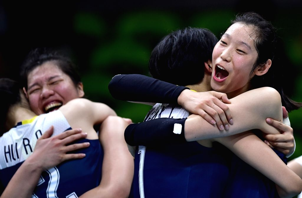 RIO DE JANEIRO, Aug. 16, 2016 - China's Zhu Ting (1st, R) celebrates with her teammates after a women's quarterfinal of Volleyball between China and Brazil at the 2016 Rio Olympic Games in Rio de ...