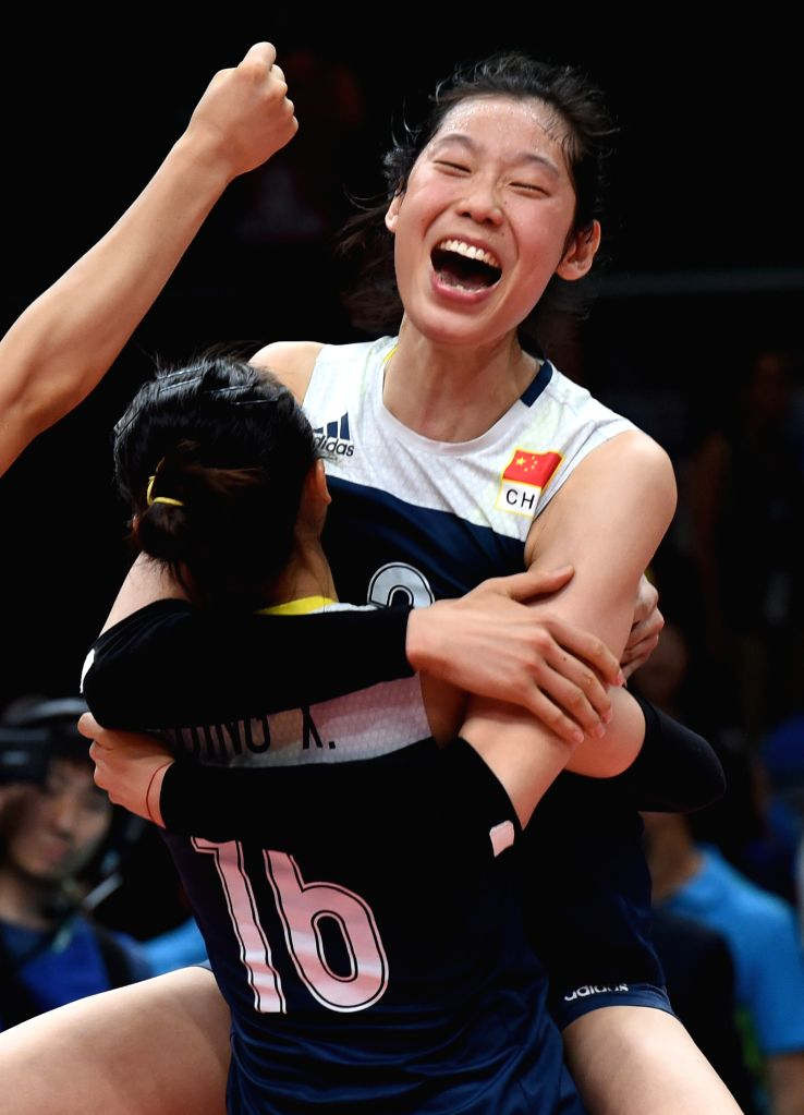RIO DE JANEIRO, Aug. 16, 2016 - China's Zhu Ting (top) celebrates with her teammate after a women's quarterfinal of Volleyball between China and Brazil at the 2016 Rio Olympic Games in Rio de ...