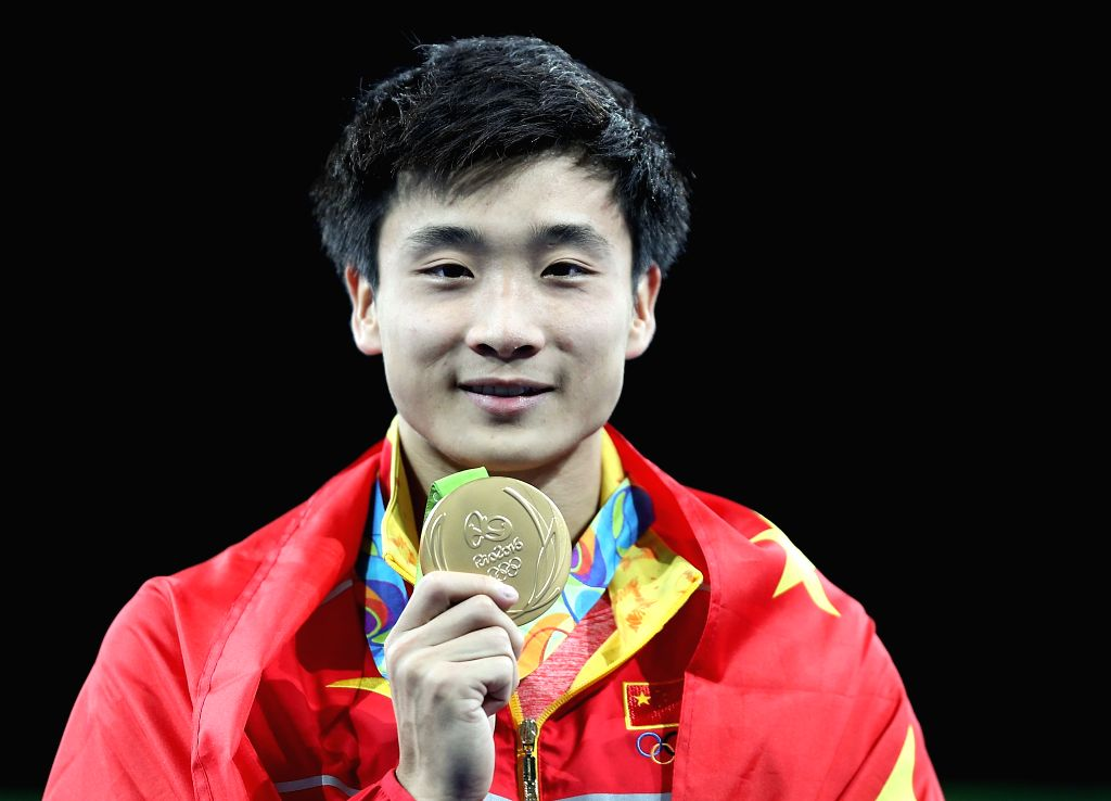 RIO DE JANEIRO, Aug. 16, 2016 - Gold medalist China's Cao Yuan attends the awarding ceremony for the men's 3m springboard final of Diving at the 2016 Rio Olympic Games in Rio de Janeiro, Brazil, on ...