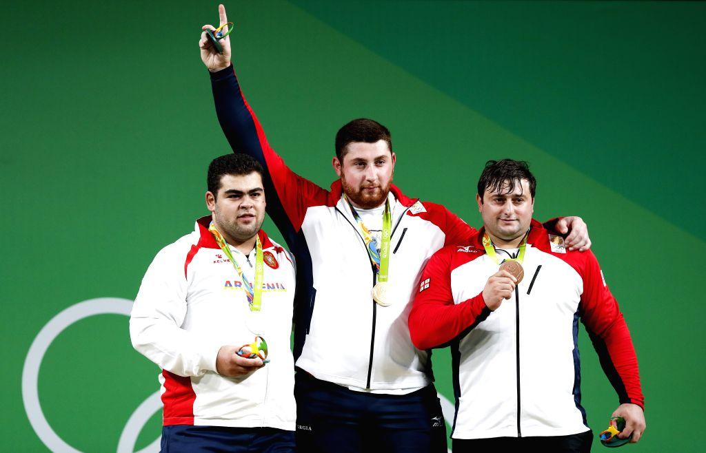 RIO DE JANEIRO, Aug. 16, 2016 - Gold medalist Georgia's Lasha Talakhadze (C), silver medalist Armenia's Gor Minasyan (L), bronze medalist Georgia's Irakli Turmanidze atttend the awarding ceremony for ...