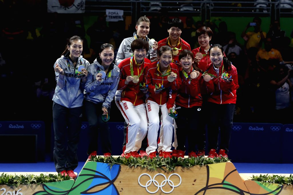 RIO DE JANEIRO, Aug. 16, 2016 - Gold medalists China's athletes, silver medalists Germany's athletes and bronze medalists Japan's athletes pose for photos during the awarding ceremony for the women's ...