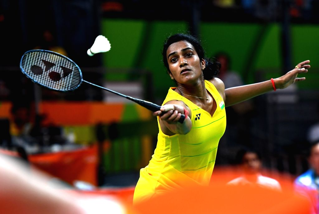 RIO DE JANEIRO, Aug. 16, 2016 - India's Pusarla V. Sindhu competes during the women's singles quarterfinal of Badminton against China's Wang Yihan at the 2016 Rio Olympic Games in Rio de Janeiro, ...