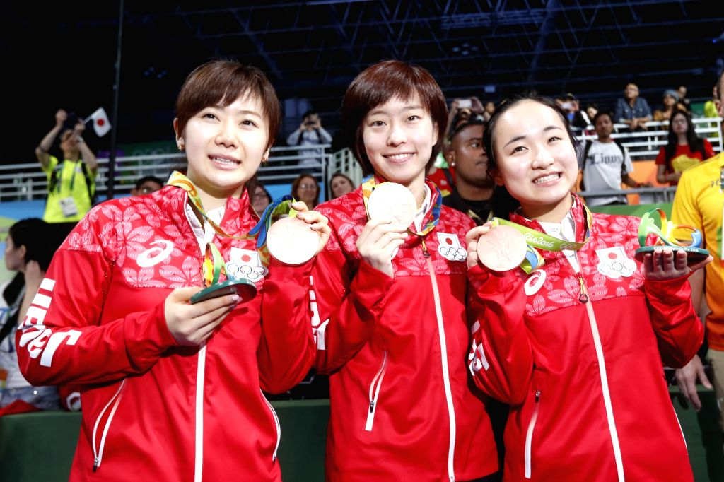 RIO DE JANEIRO, Aug. 16, 2016 - Japan's athletes pose for photos after the awarding ceremony for the women's team competition of Table Tennis at the 2016 Rio Olympic Games in Rio de Janeiro, Brazil, ...