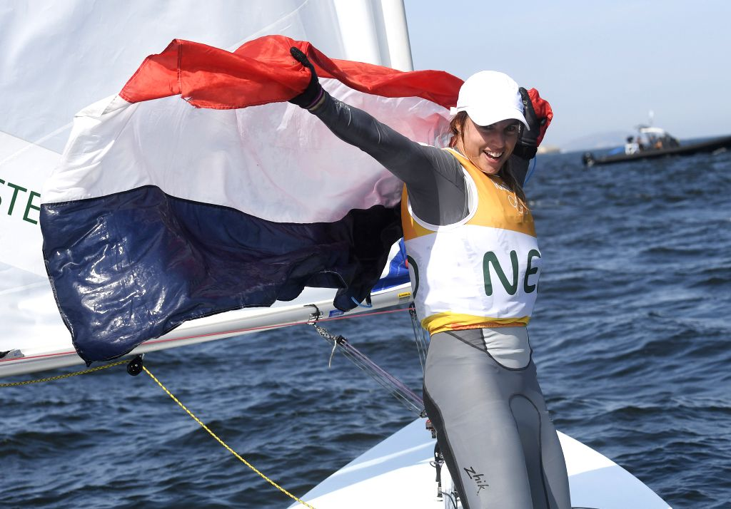 RIO DE JANEIRO, Aug. 16, 2016 - The Netherlands' Marit Bouwmeester celebrates after the women's laser radial medal race of Sailing at the 2016 Rio Olympic Games in Rio de Janeiro, Brazil, on Aug. 16, ...