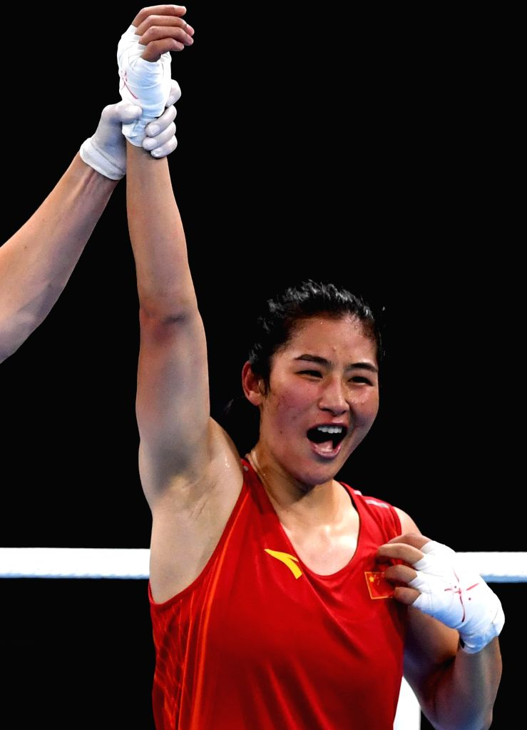 RIO DE JANEIRO, Aug. 17, 2016 - China's Li Qian celebrates after the women's middle (69-75kg) quarterfinal of Boxing against Brazil's Andreia Bandeira at the 2016 Rio Olympic Games in Rio de Janeiro, ...