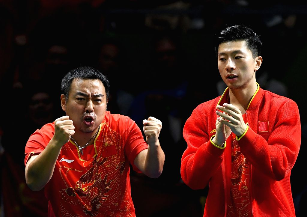 RIO DE JANEIRO, Aug. 17, 2016 - China's Ma Long (R) and coach Liu Guoliang celebrate during the men's team gold medal match of Tabel Tennis against Japan at the 2016 Rio Olympic Games in Rio de ...