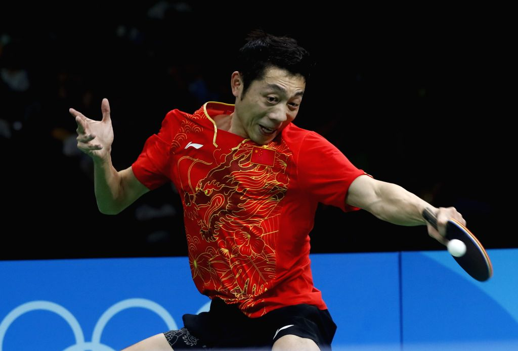 RIO DE JANEIRO, Aug. 17, 2016 - China's Xu Xin competes during the men's team gold medal match of Table Tennis against Japan at the 2016 Rio Olympic Games in Rio de Janeiro, Brazil, on Aug. 17, 2016. ...