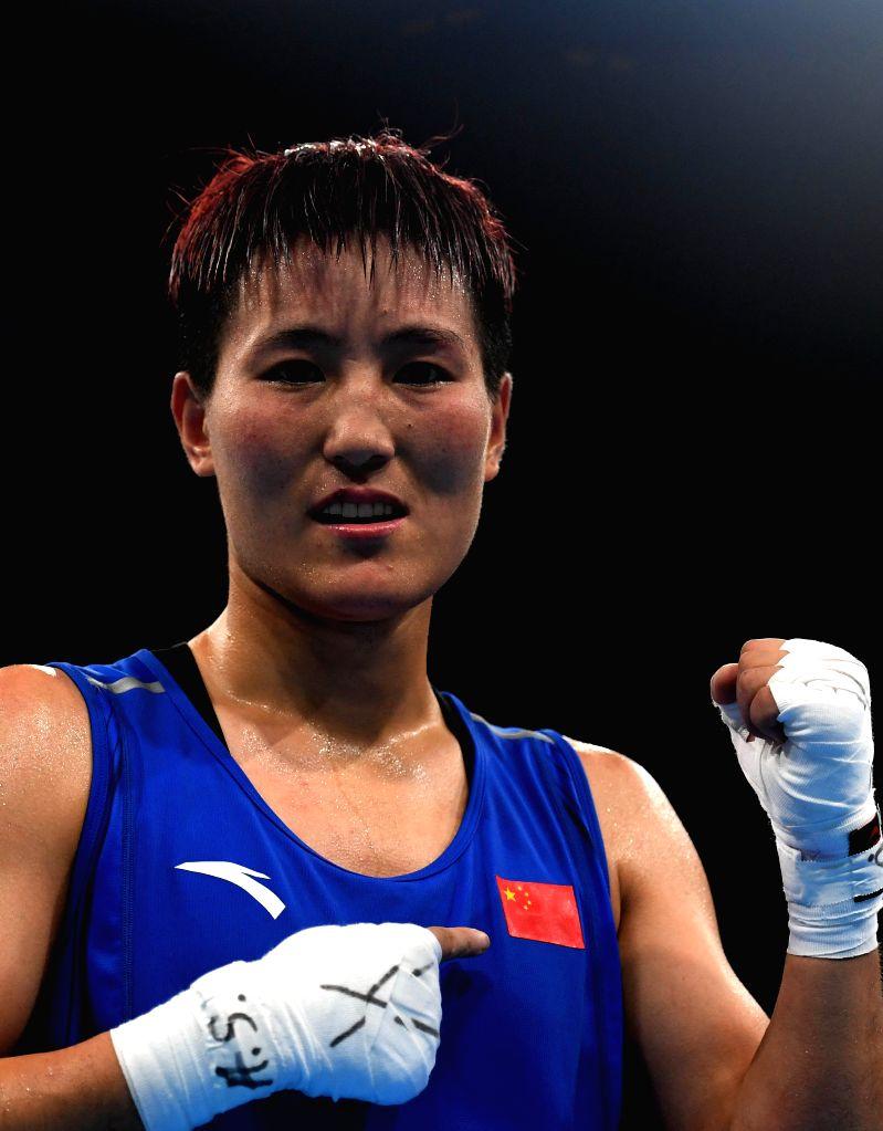 RIO DE JANEIRO, Aug. 17, 2016 - China's Yin Junhua celebrates after the women's light(57-60KG) baxing semifinal against Finland's Mira Potkonen at the 2016 Rio Olympic Games in Rio de Janeiro, ...