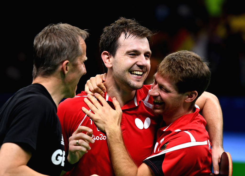 RIO DE JANEIRO, Aug. 17, 2016 - Germany's Timo Boll (C) celebrates with his teammate and coach during the men's team bronze medal match of Table Tennis against South Korea at the 2016 Rio Olympic ...