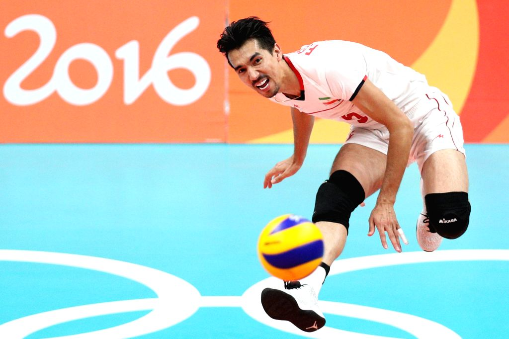 RIO DE JANEIRO, Aug. 17, 2016 - Iran's Farhad Ghaemi serves during the men's quarterfinal of Volleyball against Italy at the 2016 Rio Olympic Games in Rio de Janeiro, Brazil, on Aug. 17, 2016. Italy ...