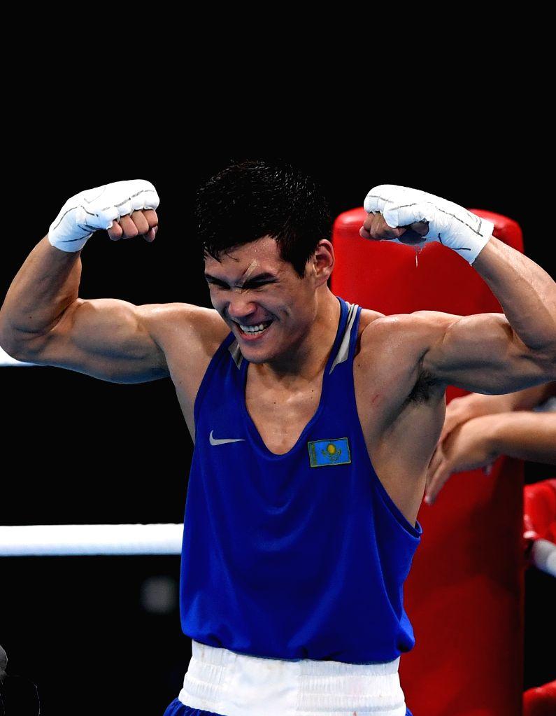 RIO DE JANEIRO, Aug. 17, 2016 - Kazakhstan's Daniyar Yeleussinov celebrates after men's welter 69kg final bout of Boxing against Uzbekistan's Shakhram Giyasov at the 2016 Rio Olympic Games in Rio de ...