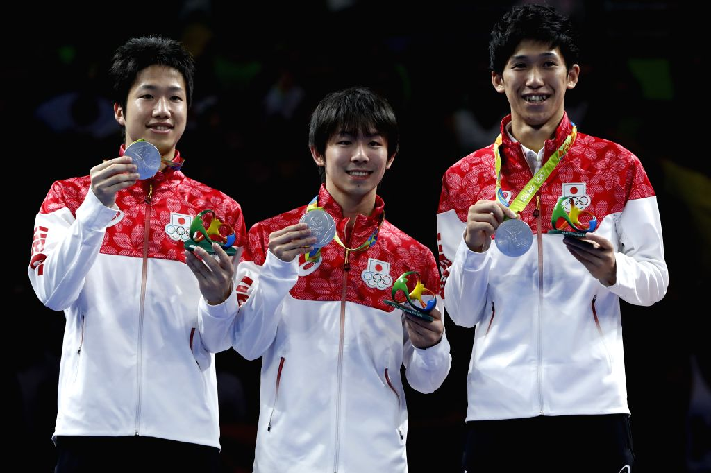 RIO DE JANEIRO, Aug. 17, 2016 - Silver medalists Japan's Jun Mizutani, Koki Niwa and Maharu Yoshimura (L-R) show their medals during the awarding ceremony for the men's team final of Table Tennis at ...