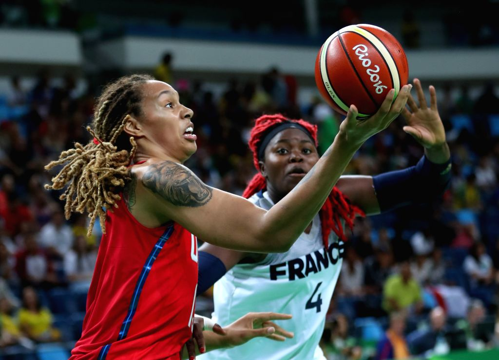 RIO DE JANEIRO, Aug. 18, 2016 - Brittney Griner (L) of the United States of America goes up for a shot during the women's semifinal of Basketball between the United States of America and France at ...