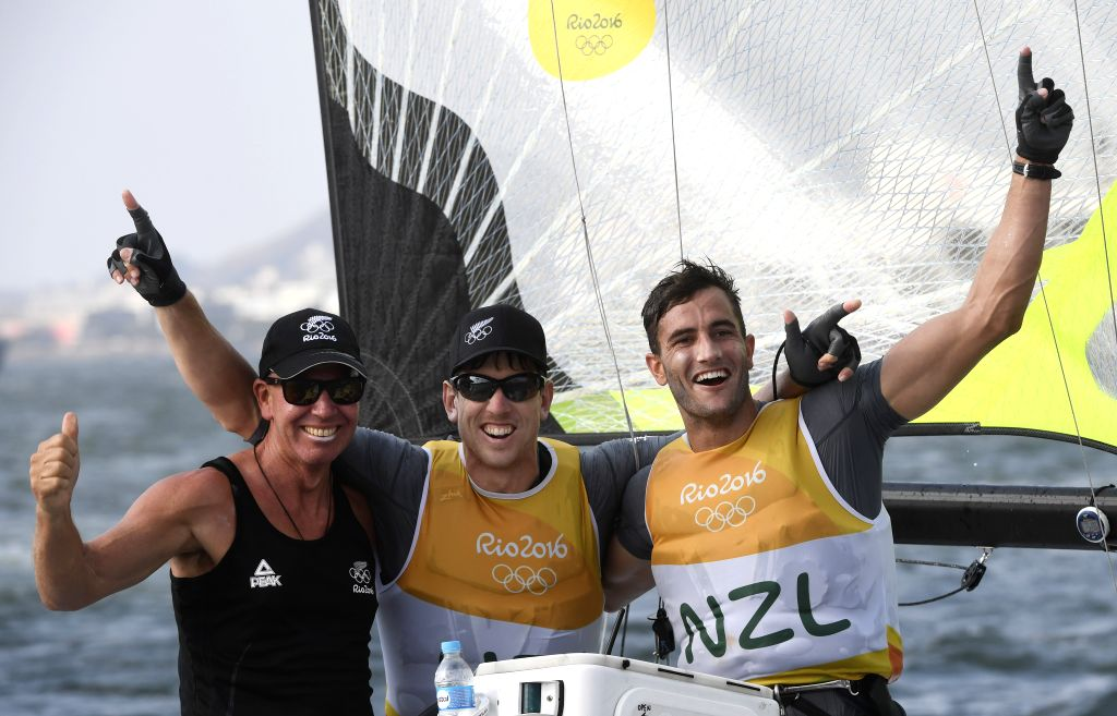 RIO DE JANEIRO, Aug. 18, 2016 - New Zealand's Peter Burling (C) and Blair Tuke (R) celebrate after the 49er men medal race of Sailing at the 2016 Rio Olympic Games in Rio de Janeiro, Brazil, on Aug. ...