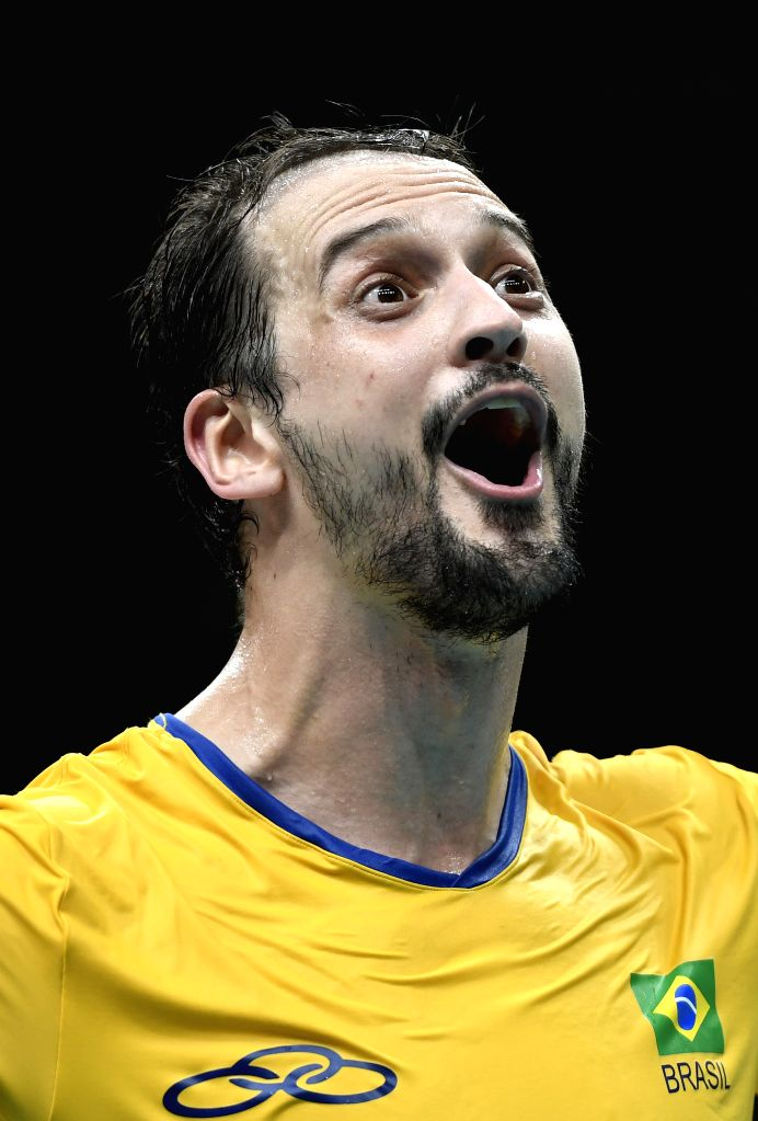RIO DE JANEIRO, Aug. 19, 2016 - Brazil's Luiz Felipe Marques Fonteles celebrates during the men's semifinal of Volleyball between Brazil and Russia at the 2016 Rio Olympic Games in Rio de Janeiro, ...