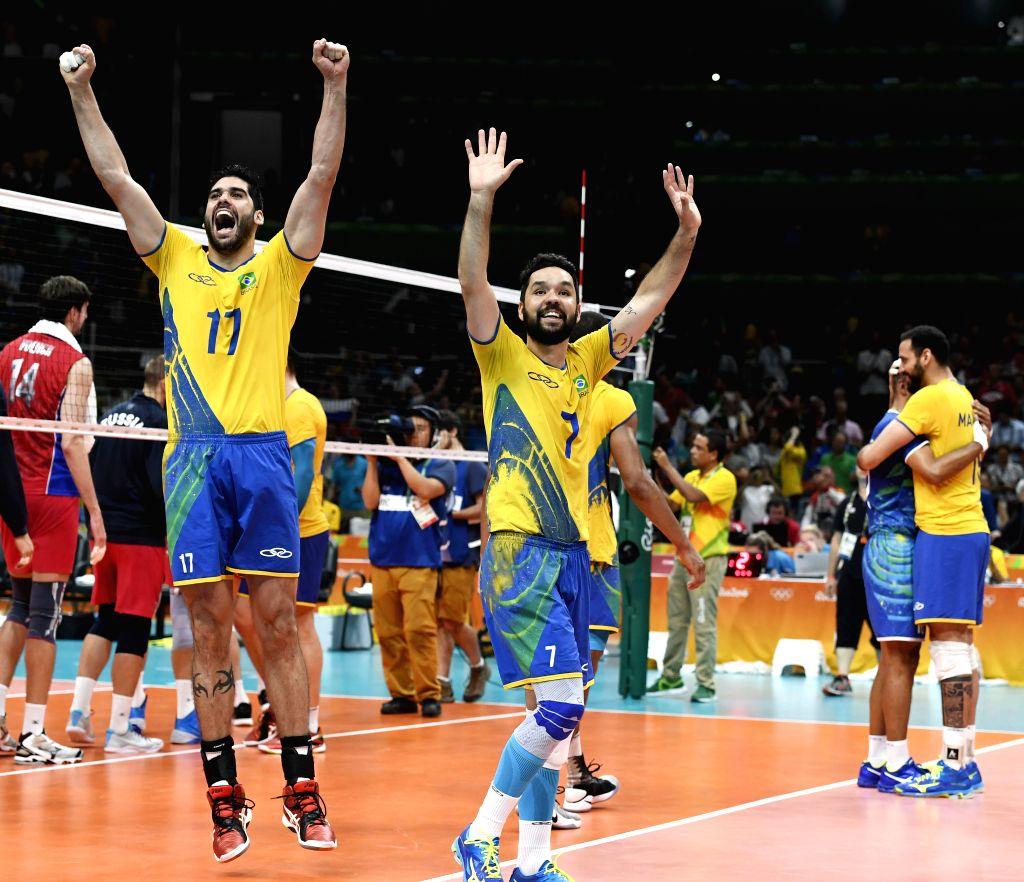 RIO DE JANEIRO, Aug. 19, 2016 - Brazil's players celebrate after the men's semifinal of Volleyball between Brazil and Russia at the 2016 Rio Olympic Games in Rio de Janeiro, Brazil, on Aug. 19, 2016. ...