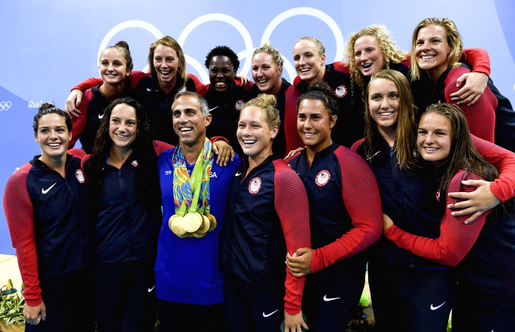 RIO DE JANEIRO, Aug. 19, 2016 - Gold medalists players of the United States of America and their coach Adam Krikorian (3rd, front) pose for photos during the awarding ceremony for the women's final ...