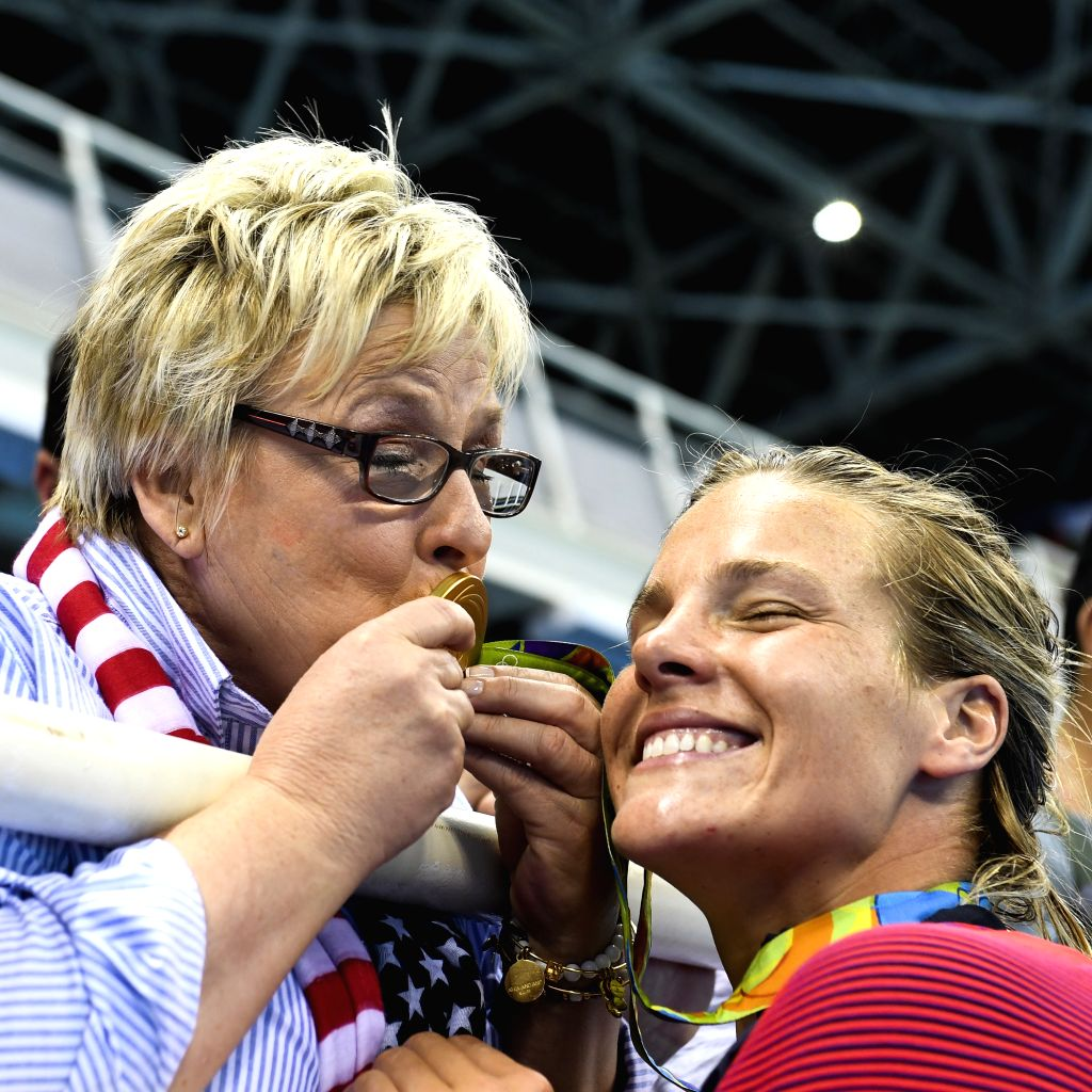 RIO DE JANEIRO, Aug. 19, 2016 - Kami Craig (R) of the United States of America celebrates with her mother Dale Craig after the awarding ceremony for the women's final of Water Polo at the 2016 Rio ...