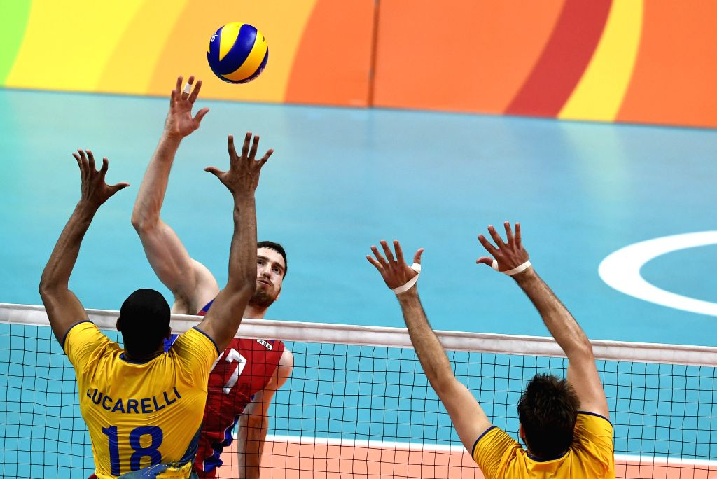 RIO DE JANEIRO, Aug. 19, 2016 - Russia's Maxim Mikhaylov (C) competes during the men's semifinal of Volleyball between Brazil and Russia at the 2016 Rio Olympic Games in Rio de Janeiro, Brazil, on ...