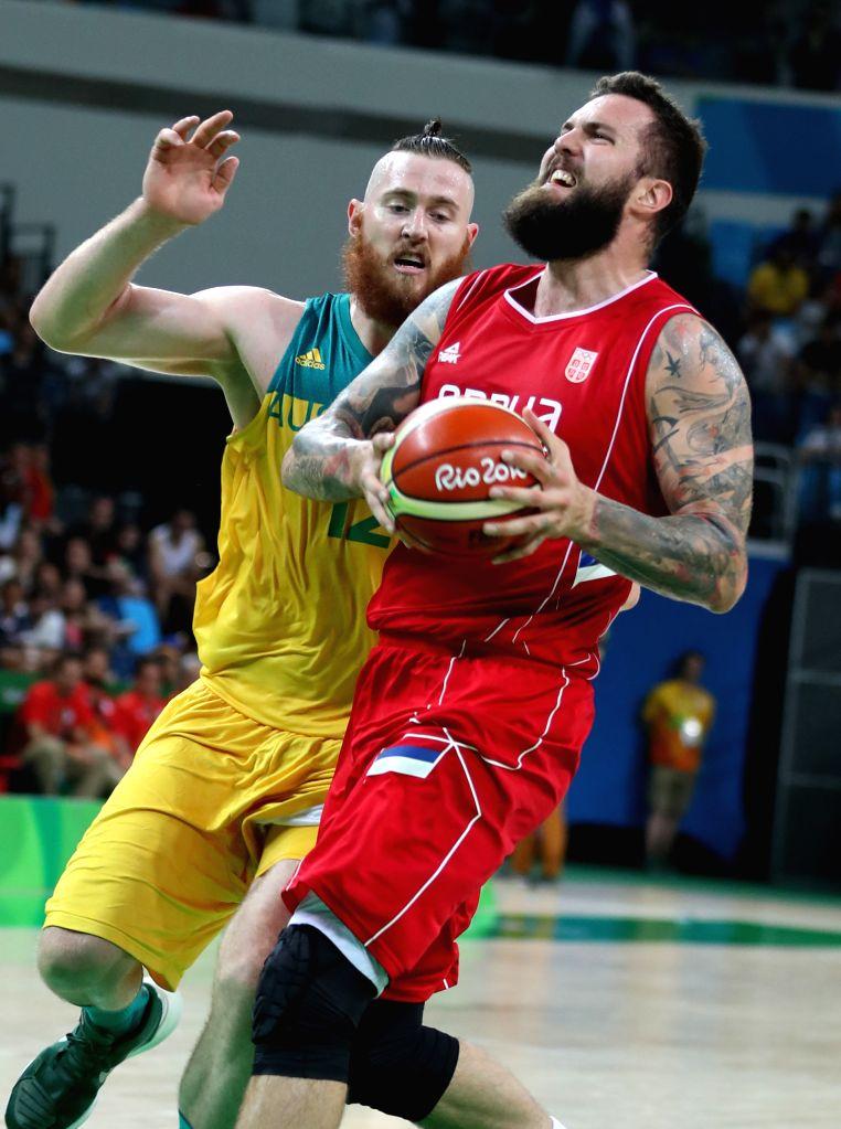 RIO DE JANEIRO, Aug. 19, 2016 - Serbia's Miroslav Raduljica (R) drives the ball during the men's semifinal of Basketball between Serbia and Australia at the 2016 Rio Olympic Games in Rio de Janeiro, ...