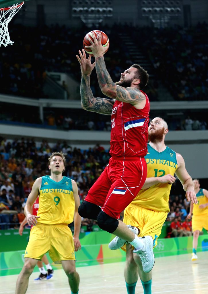 RIO DE JANEIRO, Aug. 19, 2016 - Serbia's Miroslav Raduljica (C) goes up for a shot during the men's semifinal of Basketball between Serbia and Australia at the 2016 Rio Olympic Games in Rio de ...