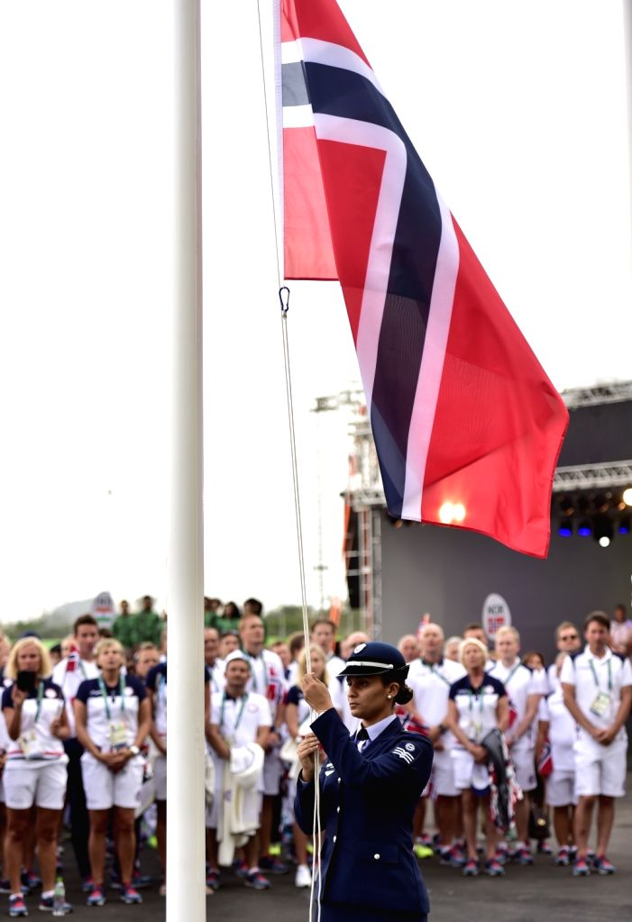 RIO DE JANEIRO, Aug. 2, 2016 - The national flag of Norway is raised at the Olympic village in Rio de Janeiro, Brazil, on Aug. 2, 2016.