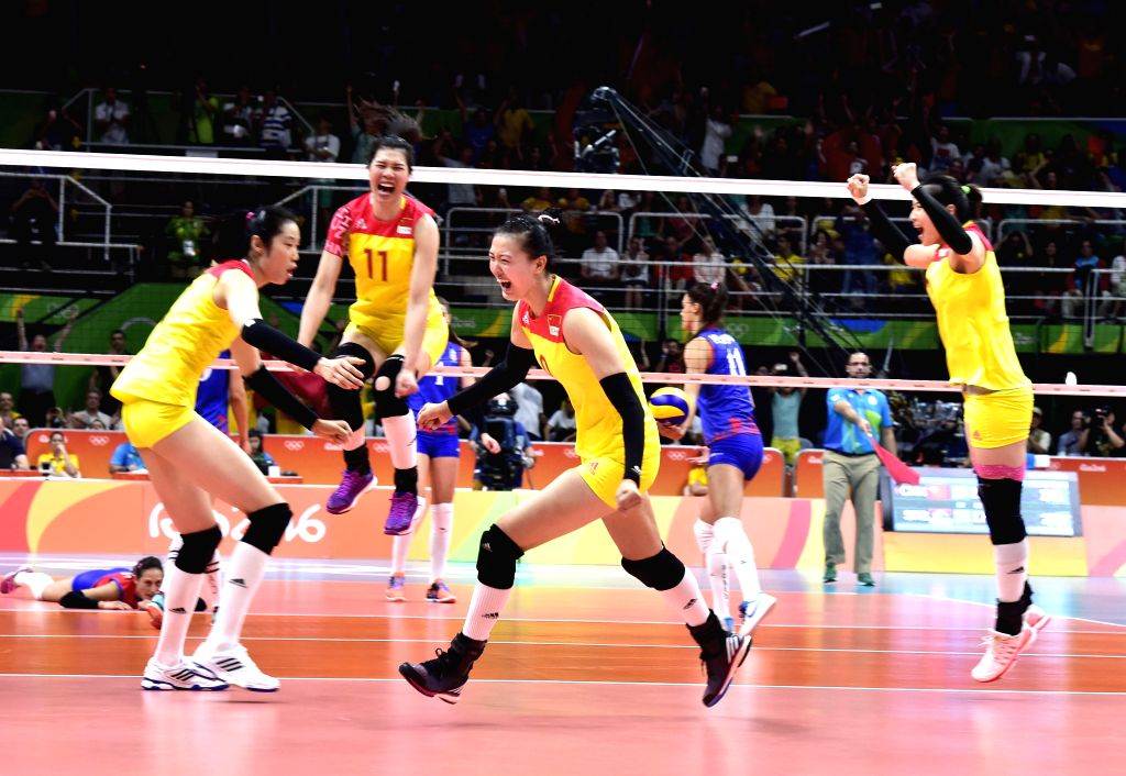 RIO DE JANEIRO, Aug. 20, 2016 - China's players celebrate after the women's gold medal match of Volleyball against Serbia at the 2016 Rio Olympic Games in Rio de Janeiro, Brazil, on Aug. 20, 2016. ...
