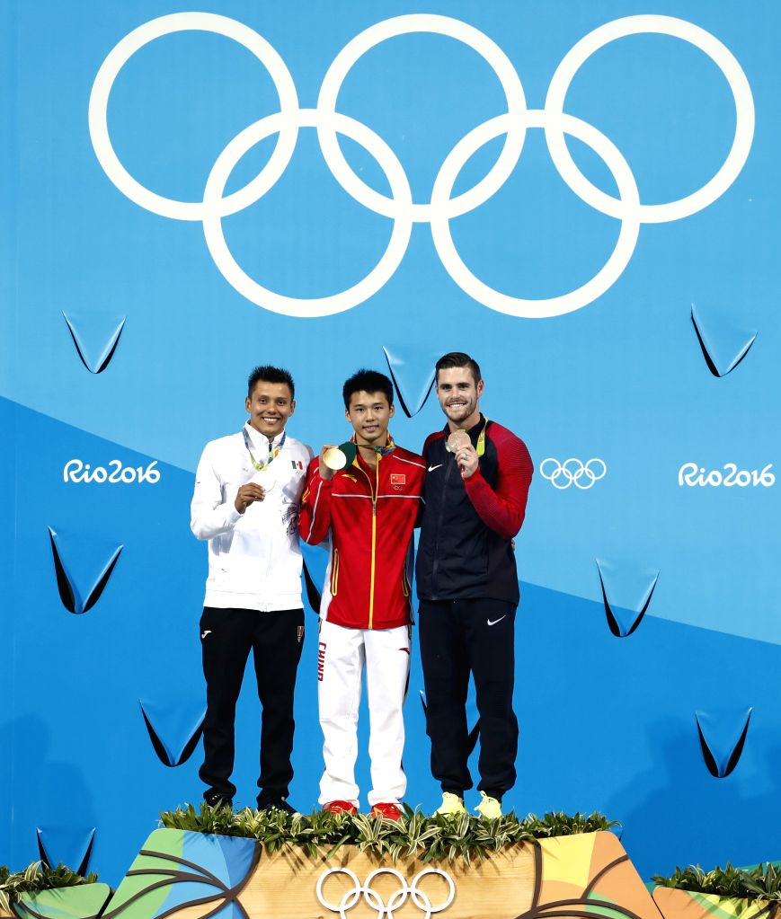 RIO DE JANEIRO, Aug. 20, 2016 - Gold medalist China's Chen Aisen (C), silver medalist Mexico's German Sanchez (L), bronze medalist David Boudia of the United States of America attend the awarding ...