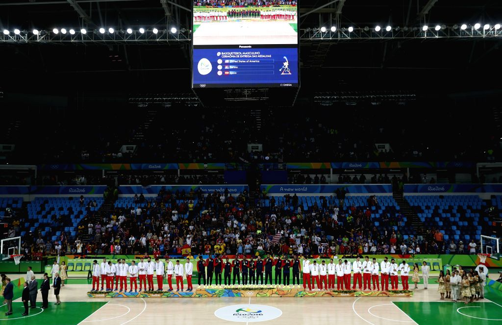 RIO DE JANEIRO, Aug. 21, 2016 - Gold medalists players of the United States of America (C), silver medalists Serbia's players (L), bronze medalists Spain's players attend the awarding ceremony for ...