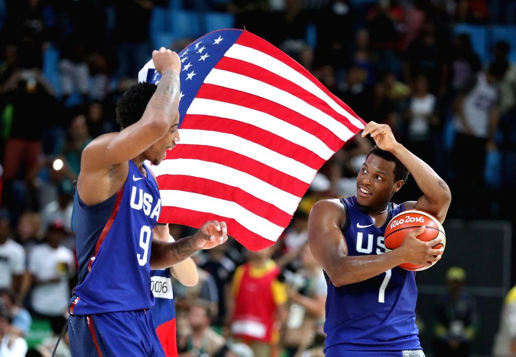 RIO DE JANEIRO, Aug. 21, 2016 - Kyle Lowry (R) of the United States of America celebrates with his teammate Demar Derozan after the men's gold medal game of Basketball against Serbia at the 2016 Rio ...