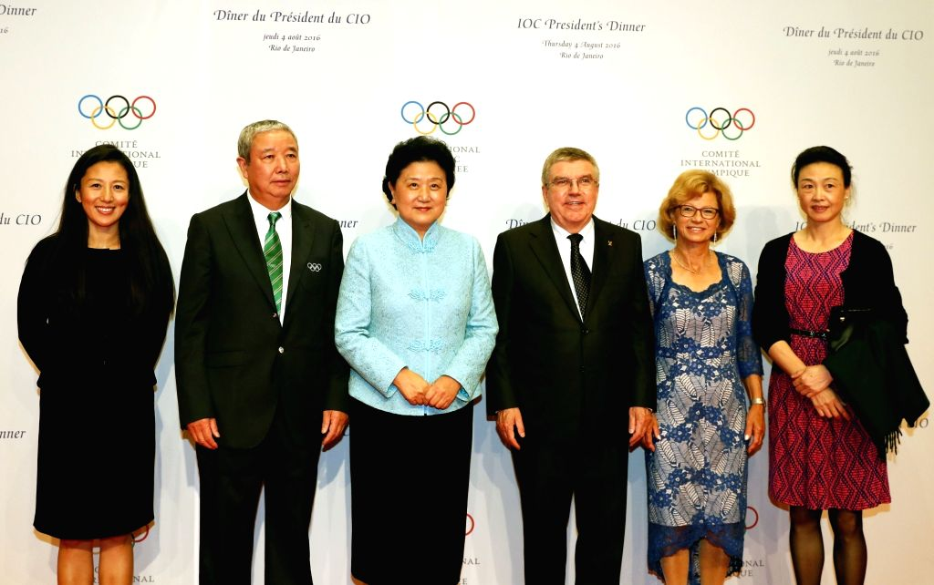 RIO DE JANEIRO, Aug. 4,2016 - Chinese vice premier Liu Yandong(3rd L) poses for photos with International Olympic Committee(IOC) President Thomas Bach(3rd R) during a welcoming banquet in Rio de ...