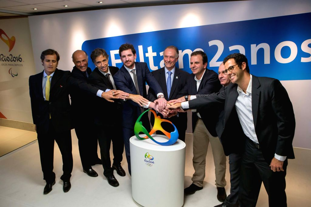 Delegates attend a ceremony marking the two-year countdown of the opening of Rio 2016 Olympic Games in Rio de Janeiro, Brazil, Aug. 4, 2014. (Xinhua/Xu ...