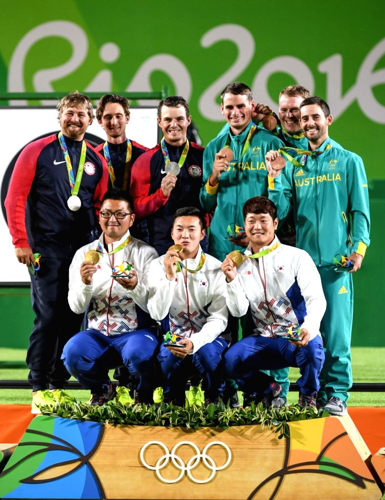 RIO DE JANEIRO, Aug. 6, 2016 - Archers of South Korea (front), United States (from 1st L to 3rd L, behind) and Australia (from 1st R to 3rd R, behind) pose for photos during the awarding ceremony for ...