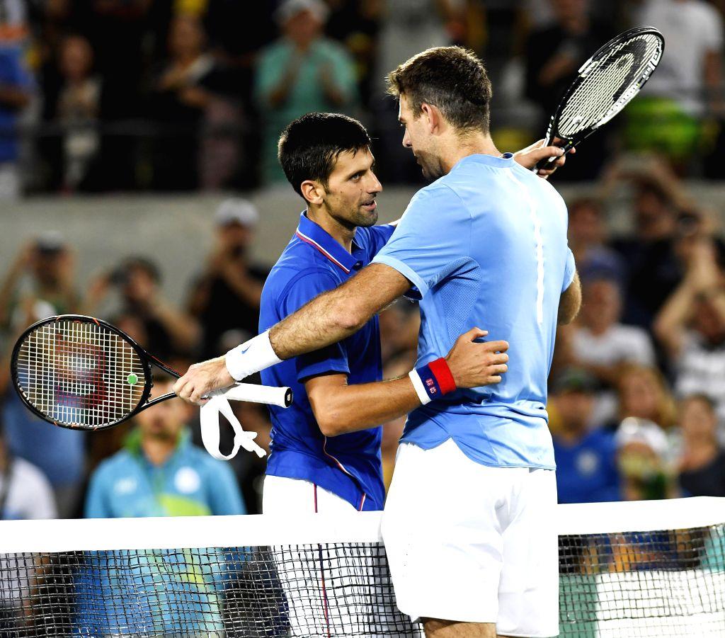 RIO DE JANEIRO, Aug. 7, 2016 (Xinhua) -- Serbia's Novak Djokovic greets Argentina's Del Potro after the first round match of men's singles tennis at the 2016 Rio Olympic Games in Rio de Janeiro, Brazil, on Aug. 7, 2016. Del Potro won the match 2-0. (