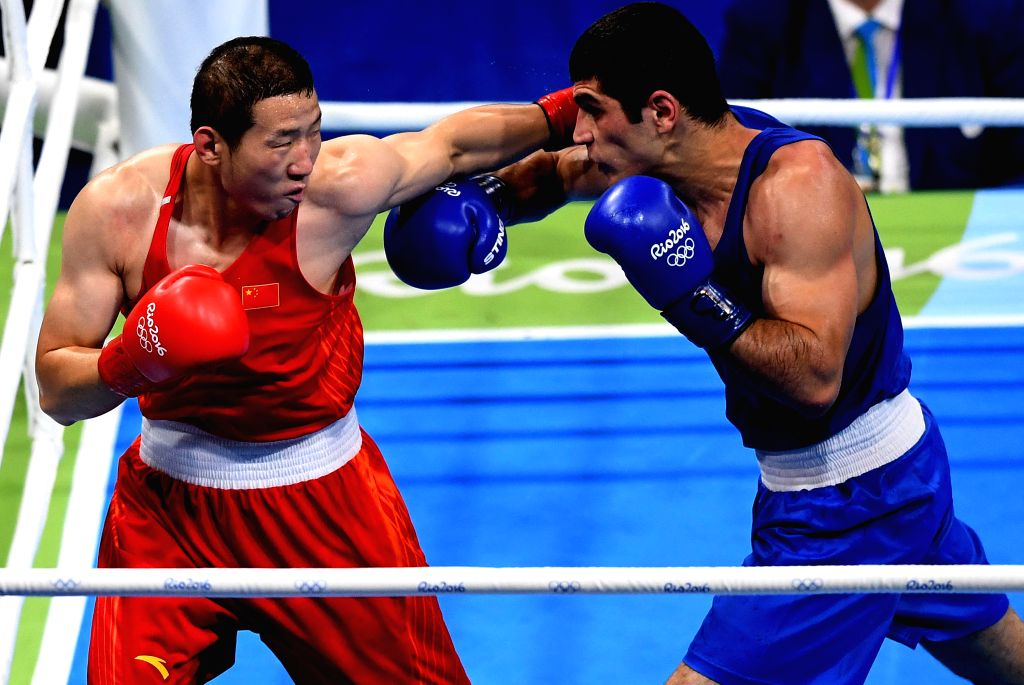RIO DE JANEIRO, Aug. 9, 2016 - China's Zhao Minggang (L) competes with Kamran Shakhsuvarly of Azerbaijan during the men's middle (75KG) preliminaries of boxing at the 2016 Rio Olympic Games in Rio de ...