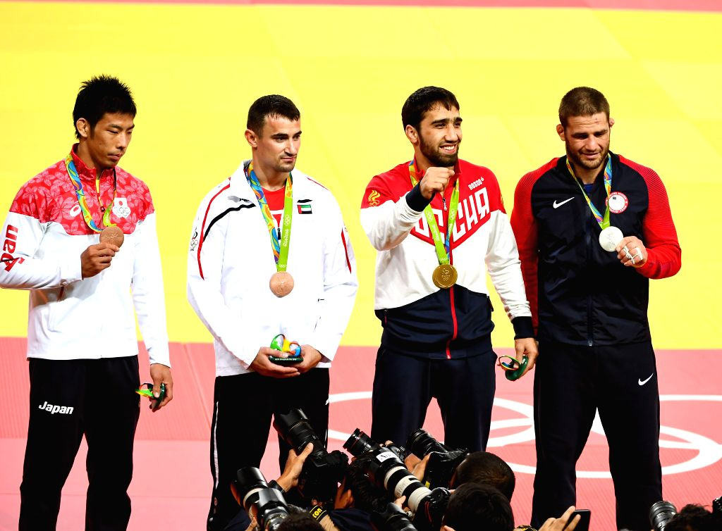 RIO DE JANEIRO, Aug. 9, 2016 - Gold medalist Khasan Khalmurzaev (2nd R) of Russia, silver medalist Travis Stevens (1st R) from the United States of American and bronze medalists Sergiu Toma of United ...