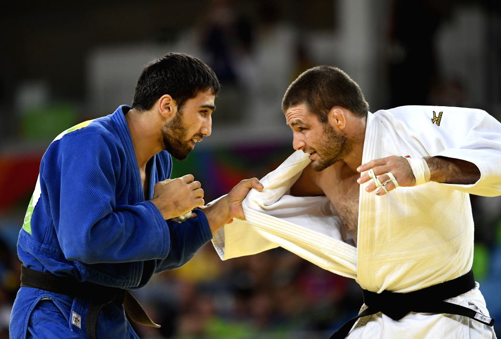 RIO DE JANEIRO, Aug. 9, 2016 - Khasan Khalmurzaev (L) of Russia celebrates after the final of men's 81KG judo between Khasan Khalmurzaev of Russia and Travis Stevens of the United States at the 2016 ...
