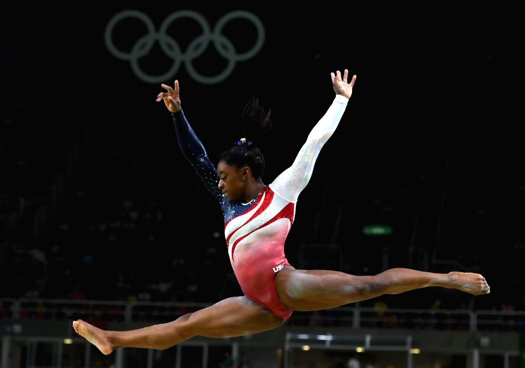 RIO DE JANEIRO, Aug. 9, 2016 - Simone Biles of the United States of America competes during a balance beam event of women's team final of Artistic Gymnasitcs at the 2016 Rio Olympic Games in Rio de ...