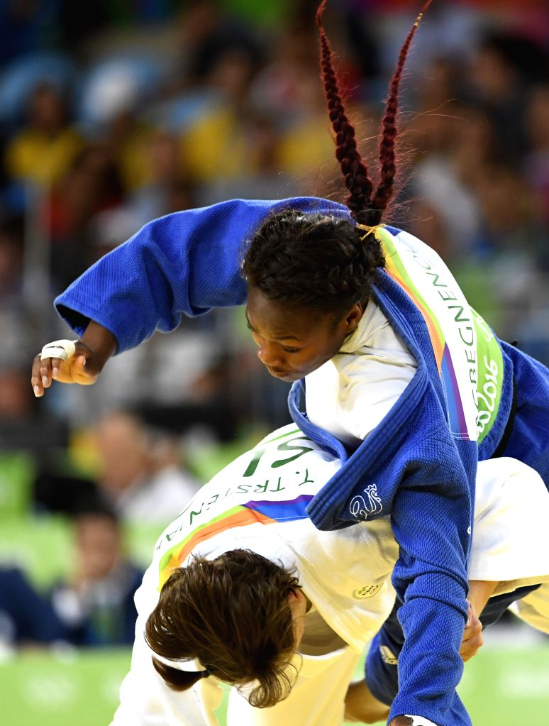 RIO DE JANEIRO, Aug. 9, 2016 - Tina Trestenjak (bottom) of Slovenia competes during the final of women's 63KG judo between Tina Trestenjak of Slovenia and Clarisse Agbegnenou of France at the 2016 ...