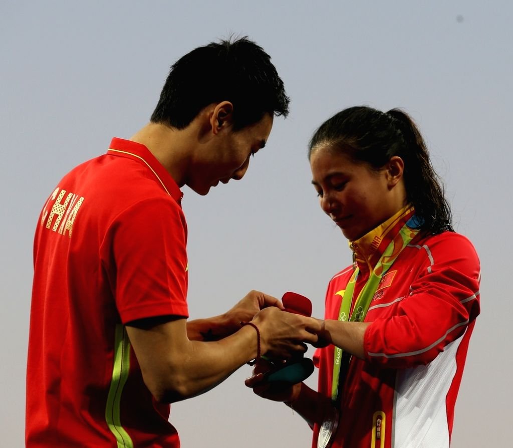 Rio de Janeiro: Chinese diver He Zi who won silver medal for the women's three-metre springboard being proposed by her boyfriend Qin Xai,at the Rio Olympics in front of spectators in Rio de Janeiro ...