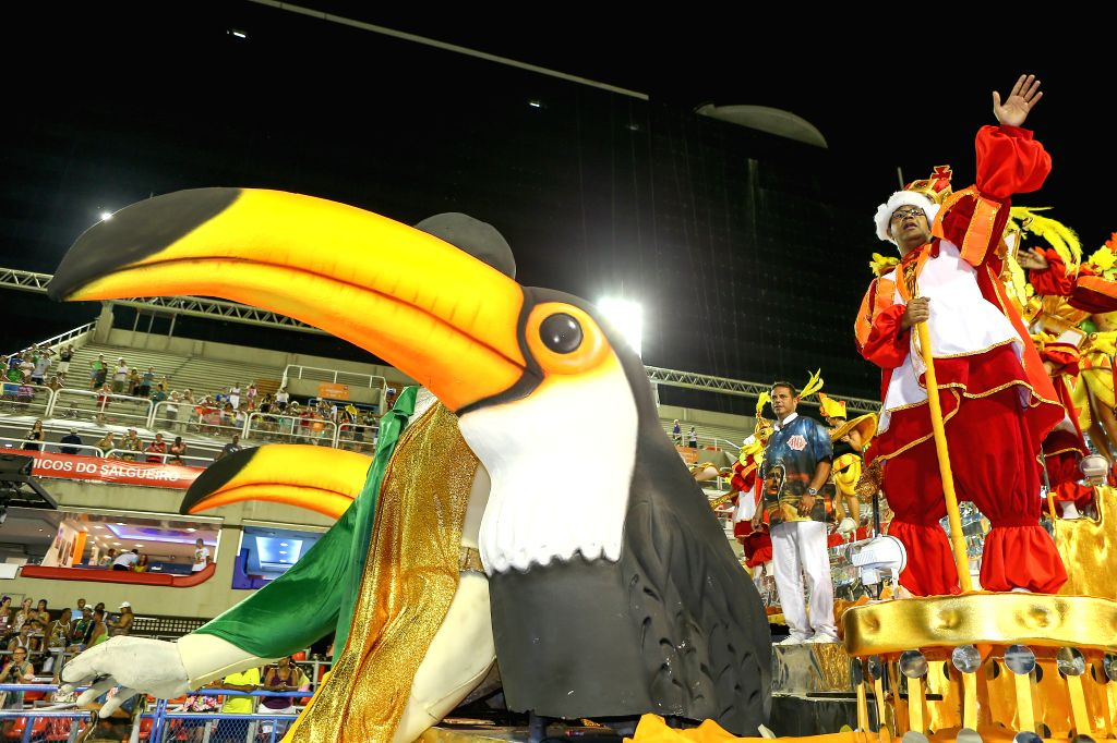 """A performer from the """"Unidos de Bangu"""" samba school participates in the first night of the annual Carnival parade at the Sambadrome in Rio de ..."""