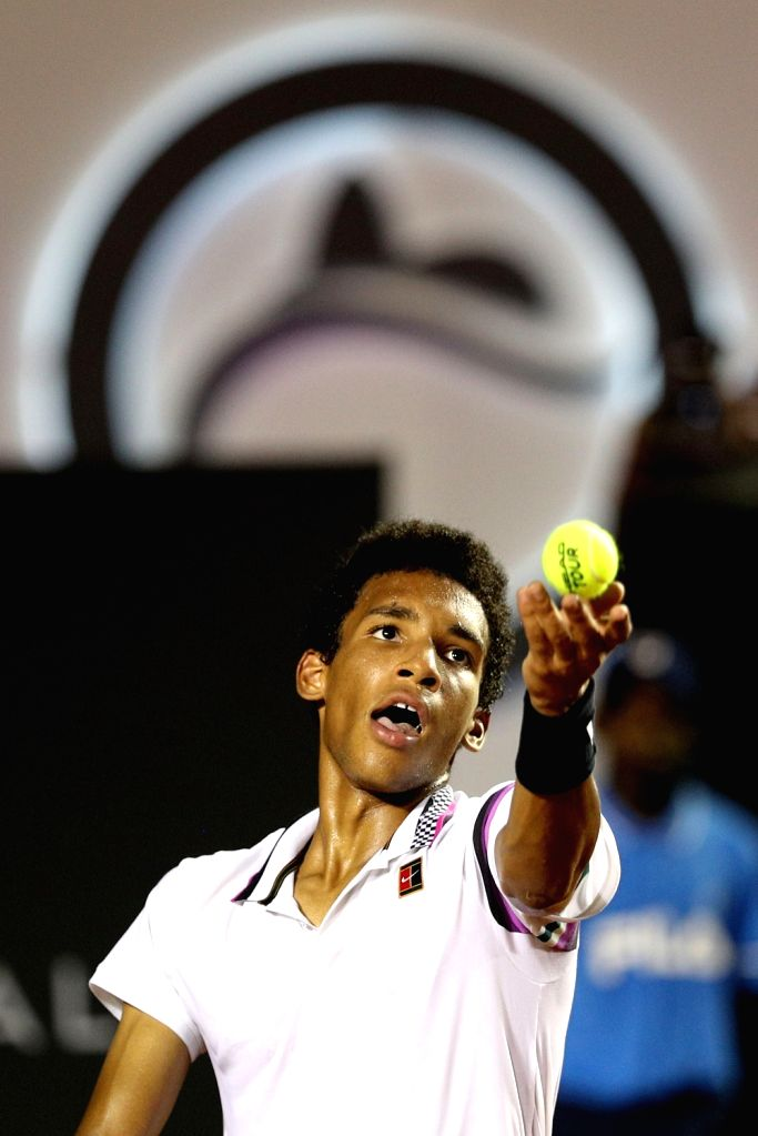 RIO DE JANEIRO, Feb. 24, 2019 - Felix Auger-Aliassime of Canada serves during the men's singles semifinal between Felix Auger-Aliassime of Canada and Pablo Cuevas of Uruguay at the Rio open 2019 ...